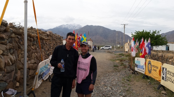 At the end of a hard day, Azaki the Kazakh-Chinese guide rests to take some water with me. He was a stud, hiking and climbing a marathon a day just like the competitors. He never complained.